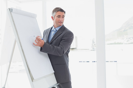 training consultant: Businessman giving a presentation in a meeting Stock Photo