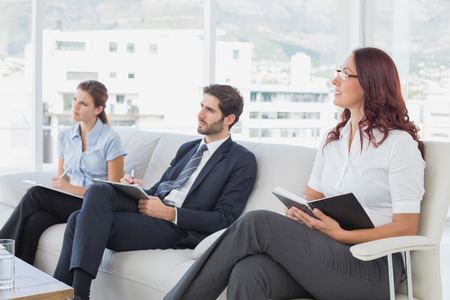 18 to 30s: Employees listening to a presentation at work Stock Photo
