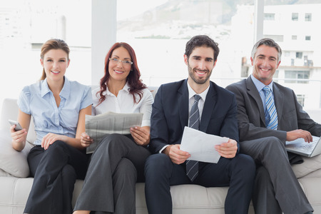 18 to 30s: Business team reviewing work notes while sitting Stock Photo