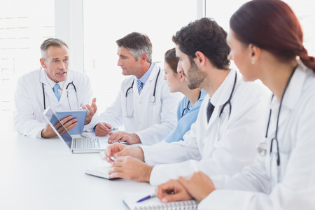 18 to 30s: Doctors having a medical discussion in a meeting room