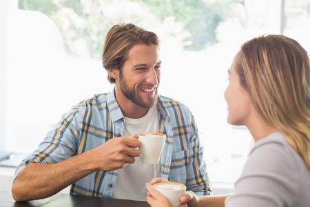 women talking: Happy couple enjoying a coffee at the coffee shop Stock Photo