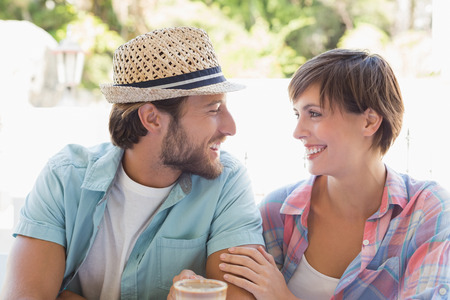 Happy couple enjoying coffee together outside at the coffee shop photo
