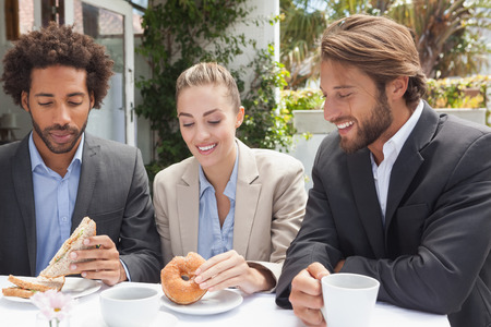 lunch hour: Business colleagues on their lunch outside at the coffee shop Stock Photo