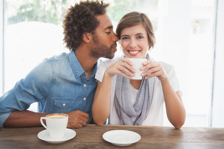 Casual couple having coffee together at the coffee shop photo
