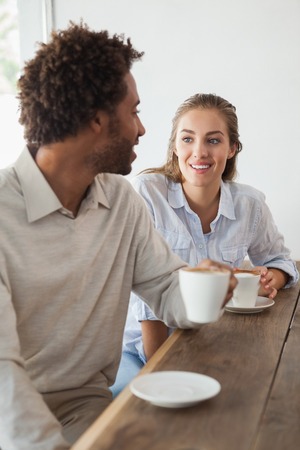 Happy couple on a date having coffee at the coffee shop photo