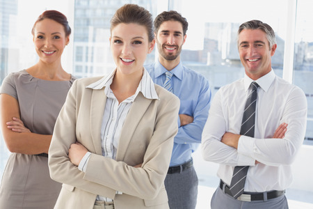 18 to 30s: Businesswoman wearing a work headset with fellow employees Stock Photo