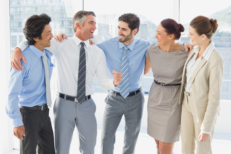 18 to 30s: Employees smiling and having fun at work Stock Photo
