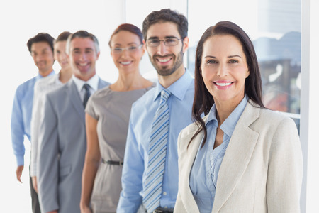 team cooperation: Smiling employees in a line at work