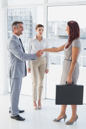 18 to 30s: Businessman shaking co-workers hand while at work