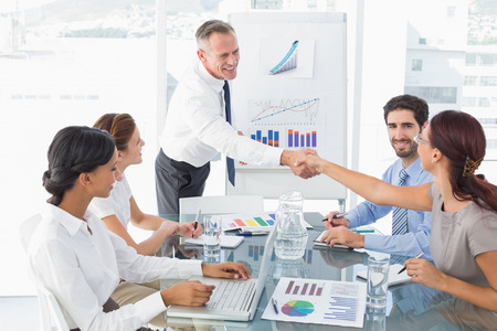 introducing: Business man introducing new employee to the company
