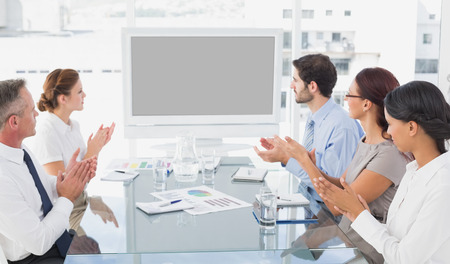 18 30s: Business colleagues watching video presentation in work Stock Photo