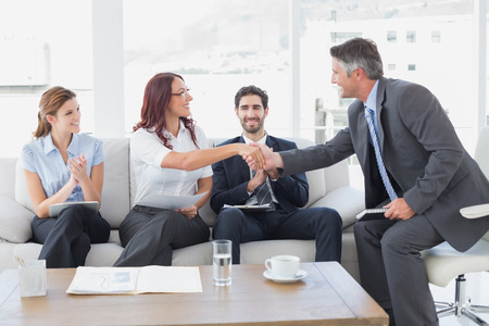 18 to 30s: Businessman shaking an employees hand in a meeting
