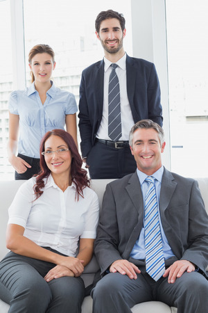 18 to 30s: Business team posing for a company photograph