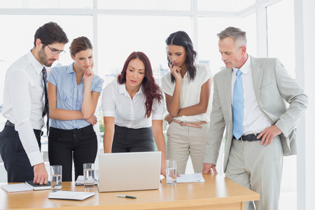 18 to 30s: Business team discussing work details in a meeting