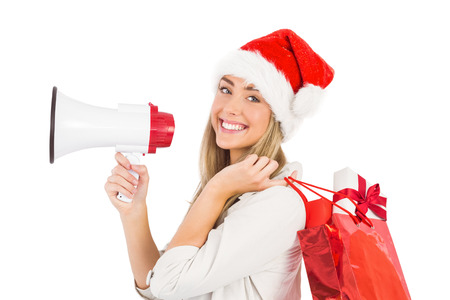consumerism: Festive blonde holding megaphone and bags on white background