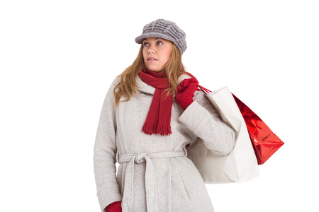 Happy blonde in winter clothes posing on white background photo