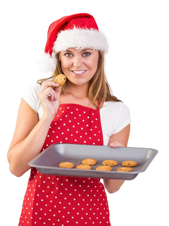 Festive homemaker showing hot cookies on white background photo