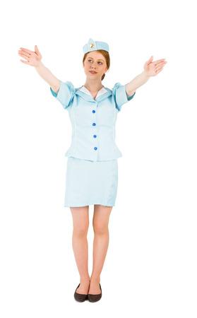 salidas de emergencia: Azafata bonita con los brazos levantados sobre fondo blanco