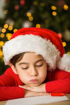 all under 18: Little girl writing letter to santa at christmas at home in the living room Stock Photo