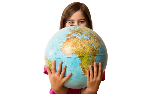 early: Cute pupil smiling holding globe on white background
