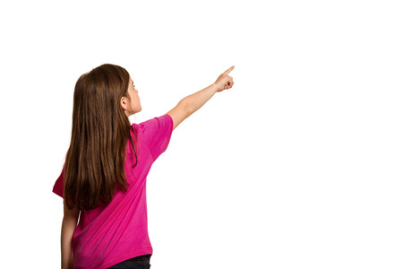 cute little girl: Cute little girl pointing with finger on white background