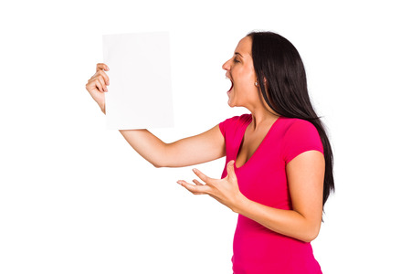 outraged: Angry woman shouting at piece of paper on white background