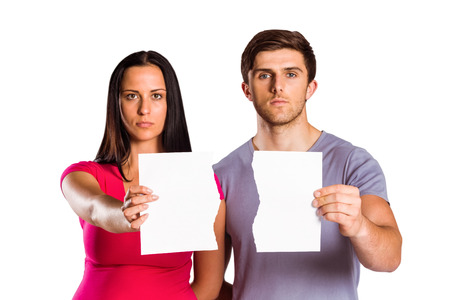 Couple showing broken piece of paper on white background photo