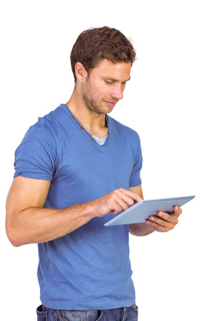scrolling: Man scrolling through tablet pc on white background Stock Photo