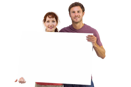 Couple holding a white sign on white background photo