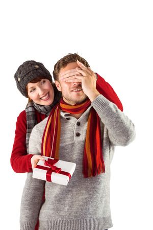 Woman giving man a present on white background