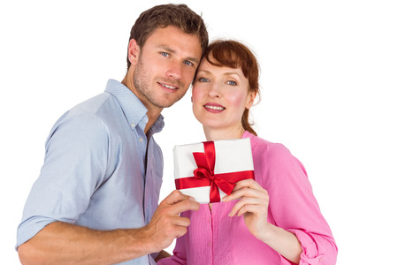Loving couple holding a gift on white background photo