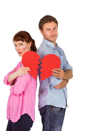 Couple holding a broken heart on white background photo