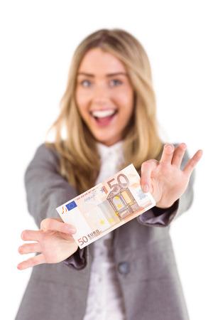 Stylish blonde showing fifty euro note on white background photo