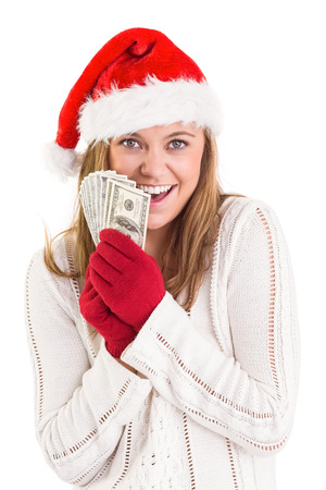 Festive blonde showing fan of dollars on white background photo