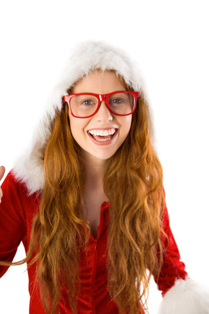 Festive redhead smiling at camera on white background photo