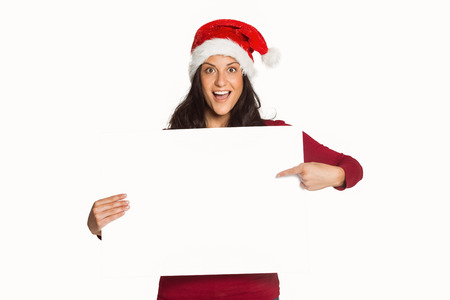 Woman pointing at white sign on a white background photo