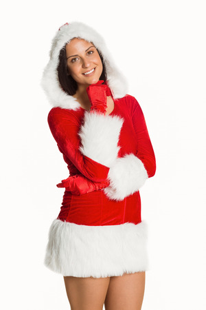 Woman wearing sexy christmas clothes on white background photo