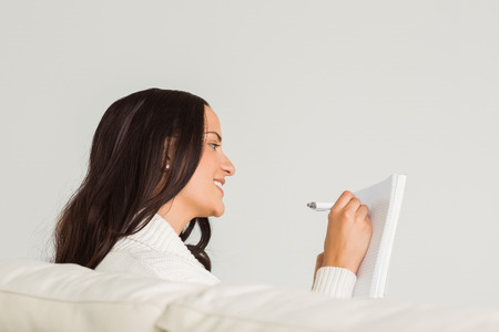 adult  body writing: Woman writing down some notes on white background