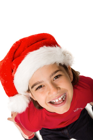 all under 18: Festive little girl smiling at camera on white background Stock Photo