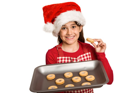 all under 18: Festive little girl offering cookies on white background