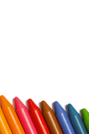 unknown age: Colourful crayons in a row on white background