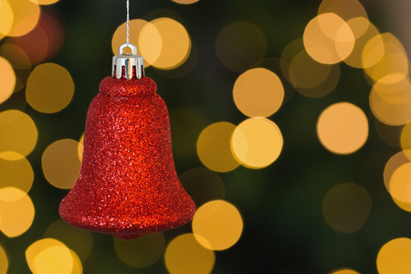 unknown age: Red christmas bell decoration hanging on blurred background Stock Photo