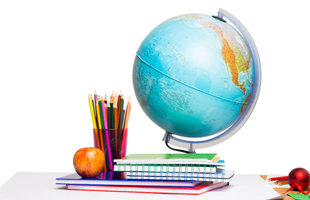 unknown age: Pupils desk with books and globe on white background