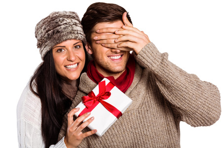 hugging couple: Young woman giving gift to boyfriend on white background