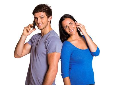 couple talking: Young couple talking on their phones on white background