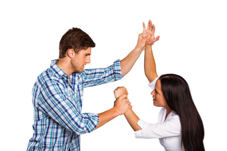 overpowering: Aggressive man overpowering his girlfriend on white background