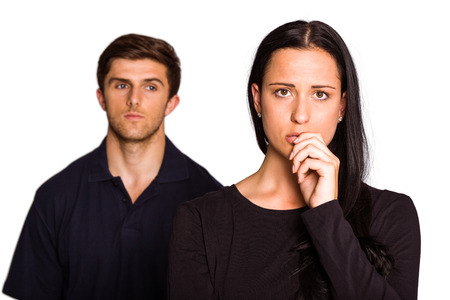 Couple not talking after argument on white background photo