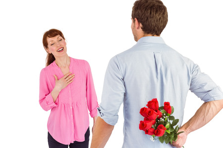 Man holding roses behind him on white background photo
