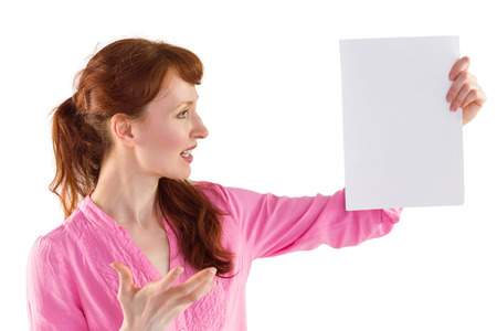 Surprised woman looking at paper on white background photo