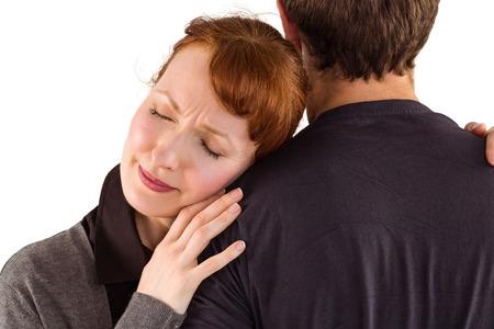 desolaci�n: Miedo mujer sosteniendo el hombre en el fondo blanco Foto de archivo